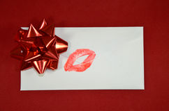 Letter with kiss. One letter with red bow and lipstick/kiss on it royalty free stock photography