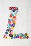Letter L of the alphabet of buttons of various shapes and colors Royalty Free Stock Photos