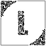 The letter L. Decorative Font with swirls and floral elements. Vintage style.  Royalty Free Stock Images