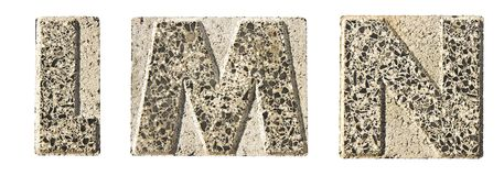 Letter L,M,N carved in a concrete block Royalty Free Stock Image