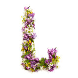The letter «L» made of various natural small flowers. Stock Images