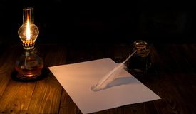 Letter in the light of an old lamp Stock Photography