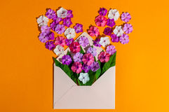Letter love. Romantic envelope with flowers on orange background. Declaration of hot feelings. Top view. Empty space for Stock Image