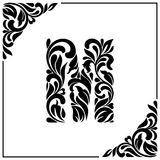 The letter M. Decorative Font with swirls and floral elements. Vintage style.  Royalty Free Stock Photography