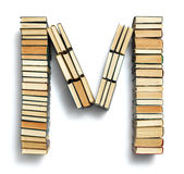 Letter M formed from the page ends of books Stock Photography
