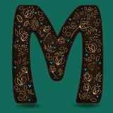 The Letter M with Golden Floral Decor. Dark brown symbol. Yellow flowers and plants with metallic blazing effect. Blue small hearts. Vector Illustration Stock Photos