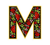 Letter M in the Russian style. The style of Khokhloma on the font. A symbol in the style of a Russian doll on a white background. The font of the football Royalty Free Stock Images