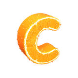 Letter made from orange. This is letter made from orange with drops of water on it Stock Images