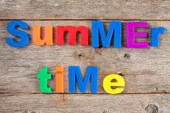 Letter magnets spelling text Summer time Stock Photography