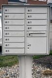 Letter - Mail - Post boxes. Communal letterboxes outside a compound Royalty Free Stock Photo