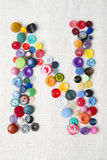 Letter N of the alphabet of buttons of various shapes and colors Stock Photo