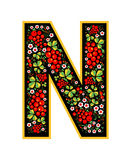 Letter N in the Russian style. The style of Khokhloma on the font. A symbol in the style of a Russian doll on a white background. The font of the football Royalty Free Stock Photo
