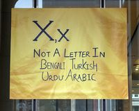 Letter X for Not a Letter in Bengali Turkish, Urdu and Arabic, vinyl banner, Immigrant Alphabet Project, Philadelphia. Pictured is the Letter X for `Not a Letter royalty free stock photos