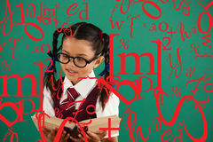 Composite image of letter and number jumble. Letter and number jumble against schoolgirl reading book against chalkboard Royalty Free Stock Photos