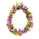 The letter «O» made of various natural small flowers. Stock Images