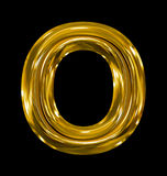 Letter O rounded shiny golden isolated on black. Background Stock Photos