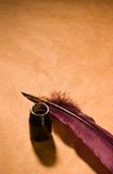 Letter old-fashioned. Still-life with  a quill and an inkwell on a rustic paper Royalty Free Stock Photo