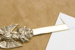 Letter opener. Antique letter opener with an eagle on the handle opening an envelope Stock Photos