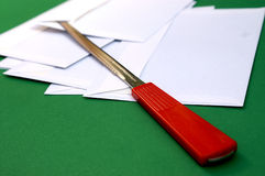 Letter Opener. Bright contrasting colours to show concept of correspondence as fun Stock Photo