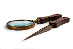 Letter opener etc.. Letter opener and magnifying glass on white background stock photos