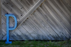 Letter P on Barn Wood Wall Royalty Free Stock Image