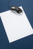 Letter paper and computer mouse Royalty Free Stock Photography