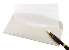 Letter Paper, Envelope and Pen. Letter paper, envelope and a wooden pen isolated in white stock photos