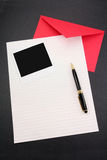 Letter paper and red envelope Royalty Free Stock Images