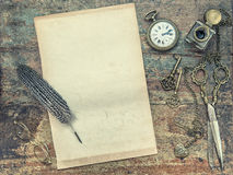 Letter paper with vintage writing tools. Feather pen and inkwell Stock Photos
