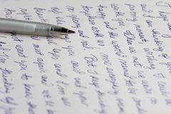 Letter and Pen. A handwritten love letter with a silver ballpoint pen Stock Photo