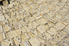 Letter. Printing letters on the stones Royalty Free Stock Photography