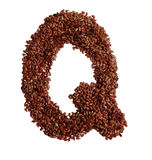 Letter Q made with Linseed also known as flaxseed isolated on wh Stock Image