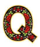 Letter Q in the Russian style. The style of Khokhloma on the font. A symbol in the style of a Russian doll on a white background. Stock Photography