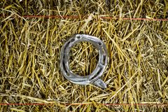 Letter Q Steel Horseshoe on Straw stock photo