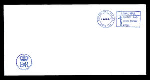 Letter from Queen Elizabeth II. Blank postally used envelope from Buckingham Palace which is oficial residence of the Queen Elizabeth II with postmark and logo Stock Images