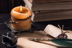 Letter with quil pen and lighted candle Royalty Free Stock Photos