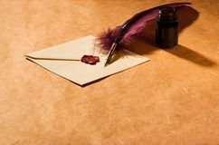 Letter, quill, inkwell. Still-life with  a letter, a quill and an inkwell Stock Photo