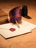 Letter, quill, inkwell & diary. Still-life with  a letter, a quill , an inkwell and a dairy. Valentine Card Royalty Free Stock Photography