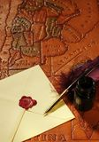 Letter, quill, inkwell & map. Still-life with a map of South America, a letter, a quill and an inkwell Royalty Free Stock Photo