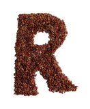 Letter R made with Linseed also known as flaxseed isolated on wh Stock Images