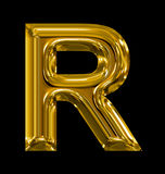 Letter R rounded shiny golden isolated on black. Background Stock Images