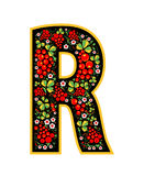 Letter R in the Russian style. The style of Khokhloma on the font. A symbol in the style of a Russian doll on a white background. Stock Photo