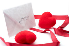 Letter, red stripe and two hearts Stock Photography