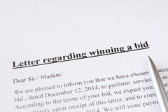 Letter regarding winning a bid or auction. business or finance concept Stock Photos