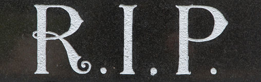 The letter RIP on a grave. The letter RIP on an old marble grave in Holland stock photography