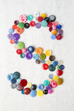 Letter S of the alphabet of buttons of various shapes and colors Stock Photos