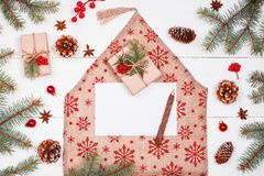 Letter for Santa on holiday background with Christmas gifts, Fir branches, pine cones, red decorations. Stock Photos