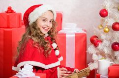 Letter for santa. Wish list. Girl little kid hold pen and paper near christmas tree writing letter. I was good girl all. Year. Child write letter to santa claus royalty free stock images