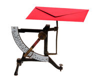 Letter scales with red envelope Stock Image