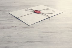 Letter with seal on table Stock Photos